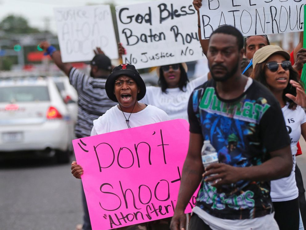 PHOTO: People demonstrate in the street as police cars pass outside the Triple S convenience store in Baton Rouge, La., Wednesday, July 6, 2016. Alton Sterling, 37, was shot and killed outside the store by Baton Rouge police, where he was selling CDs.