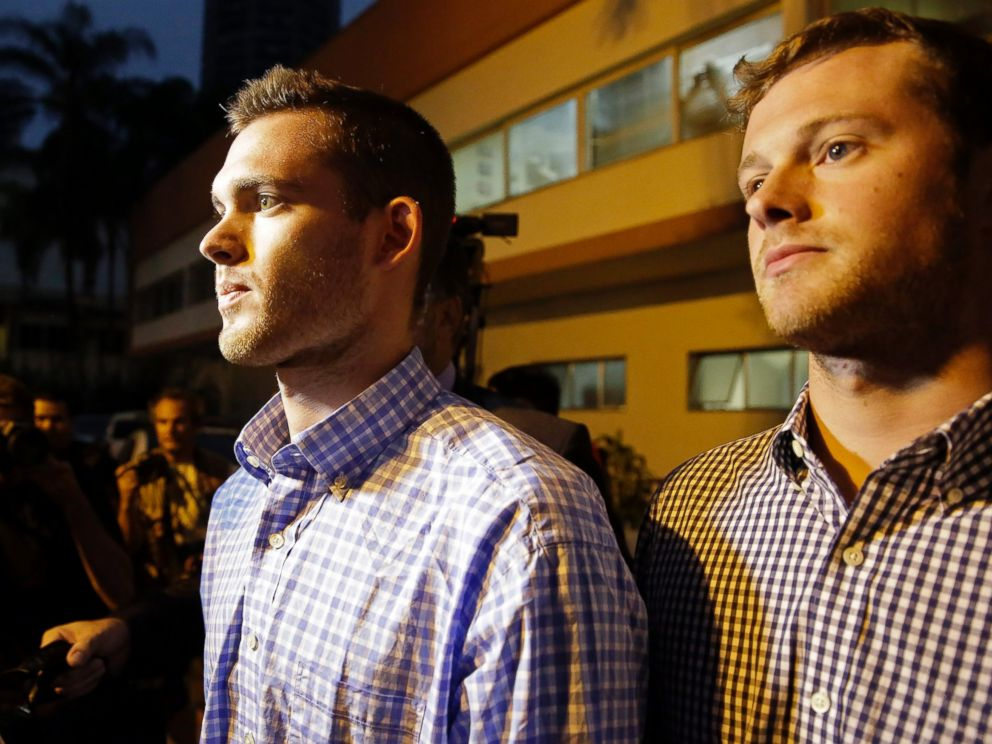 PHOTO: American Olympic swimmers Gunnar Bentz, left, and Jack Conger leave a police station in the Leblon neighborhood of Rio de Janeiro, Brazil, Thursday, Aug. 18, 2016.