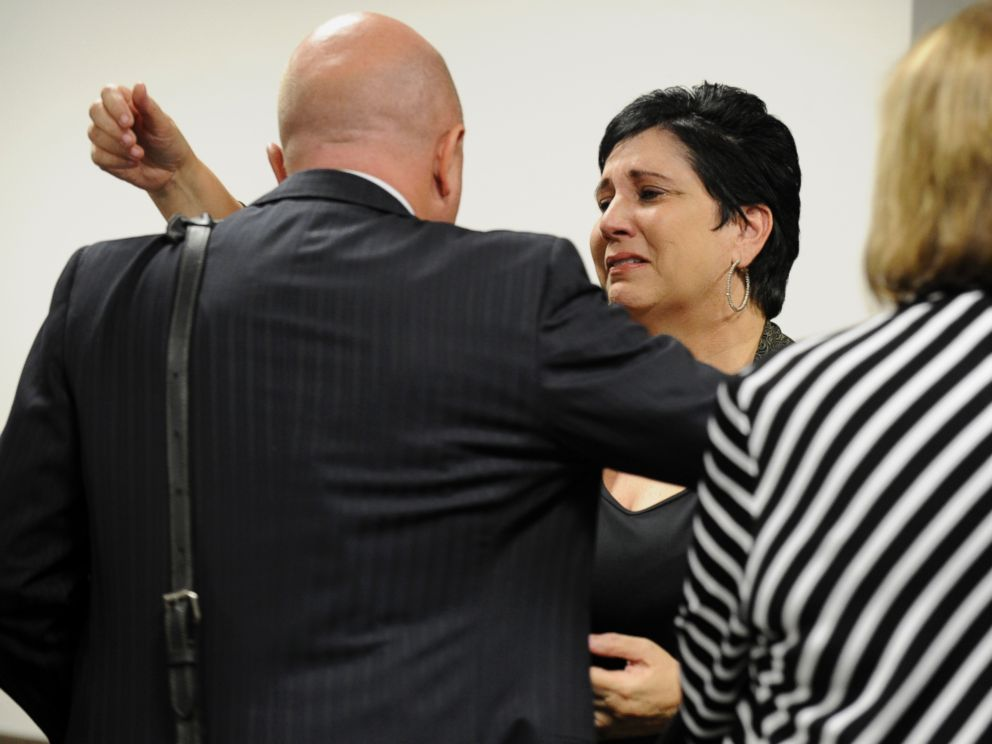PHOTO: Rosalie Bolin, the wife of Oscar Ray Bolin Jr. hugs defense attorney Bjorn Brunvand after Oscar Ray Bolin Jr. was found guilty in the killing of Natalie Blanche Holley, April 19, 2012 in Tampa.