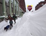 PHOTO: A couple walks past a large snow drift in the Old Port section of Portland, Maine, Feb. 9, 2013. Officials are cautioning residents to stay off the roads in Maine, where Portland set an all-time snowfall record.