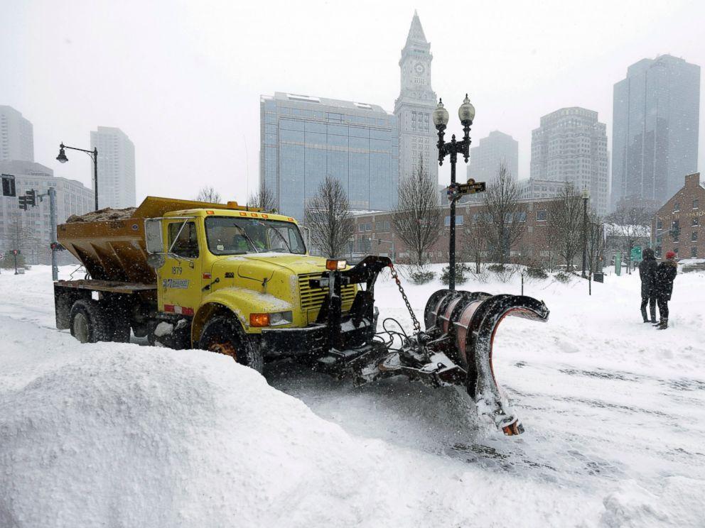 PHOTO: A snowplow clears a street near Quincy Market, on Jan. 27, 2015, in Boston.