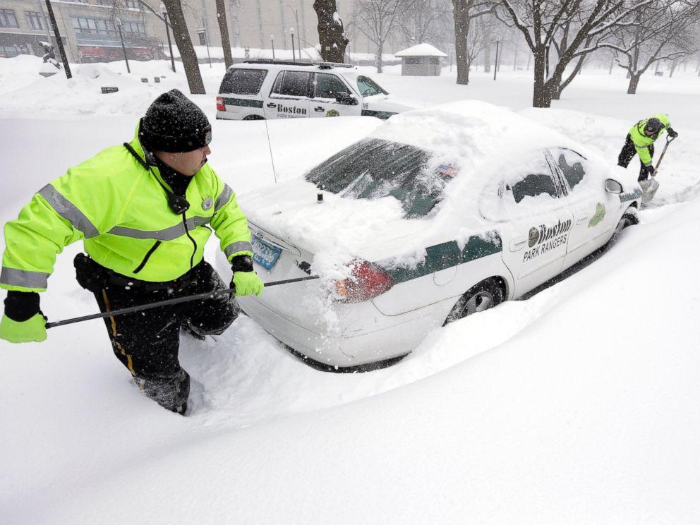 PHOTO: Boston park rangers clear snow from around their car on Feb. 9, 2015, on Boston Common.