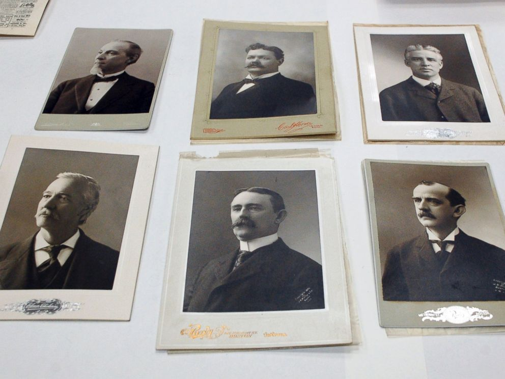 PHOTO: Photographs of city and state elected officials, including Boston Mayor Thomas Norton Hart at top left, are displayed after they were taken from a 1901 time capsule in Boston.