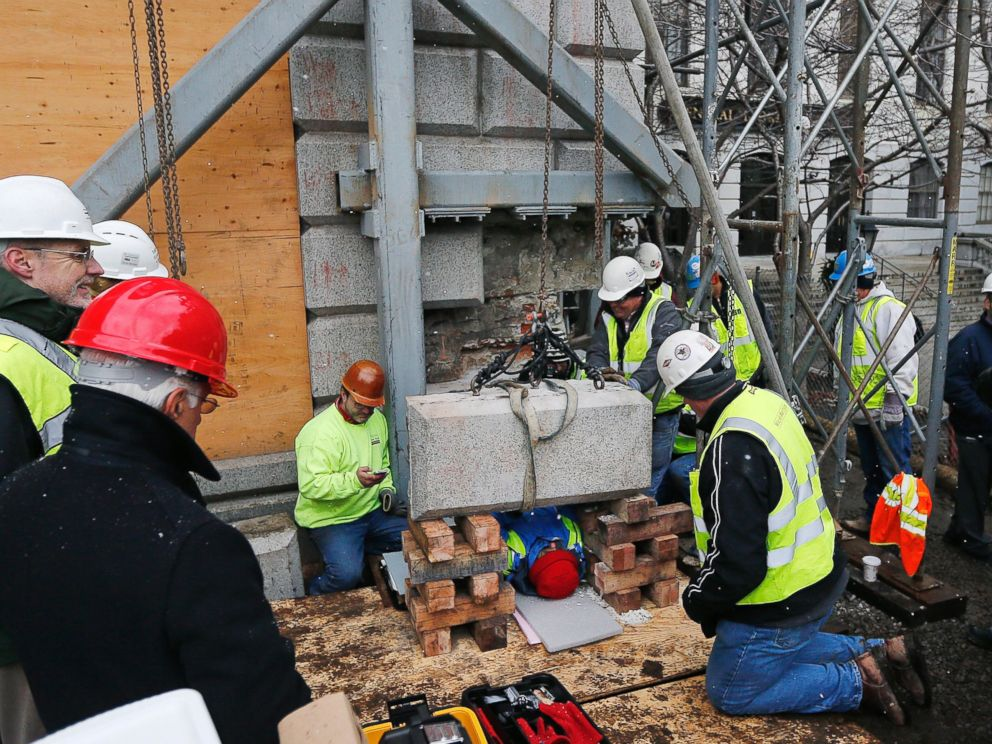 PHOTO: Massachusetts officials work to remove a time capsule in the cornerstone of the Statehouse in Boston, Dec. 11, 2014.