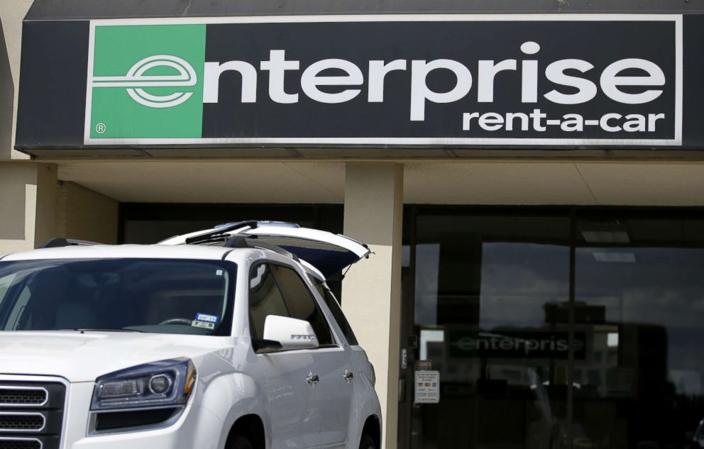 PHOTO: A vehicle with its rear tailgate opened sits parked in front of a Enterprise Rent-A-Carl location, Wednesday, Oct. 2, 2013, in Dallas.