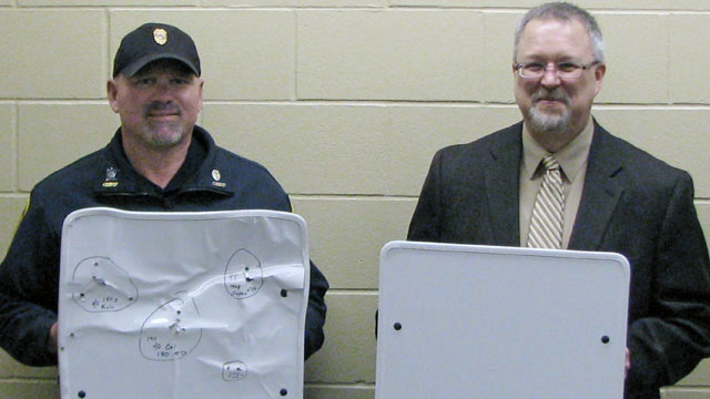 PHOTO: Cold Spring Police Chief Phil Jones, left, and Rocori School District Superintendent Scott Staska pose with bulletproof white boards in Cold Spring, Minn., APril 22, 2013.