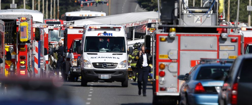 PHOTO: A Ride the Ducks tour bus that was involved in a crash with several other vehicles can be seen behind an ambulance as officials respond, Sept. 24, 2015 in Seattle.