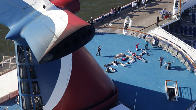"PHOTO: Passengers spell out the word ""HELP"" aboard the disabled Carnival Lines cruise ship Triumph as it is towed to harbor off Mobile Bay, Ala., Feb. 14, 2013."