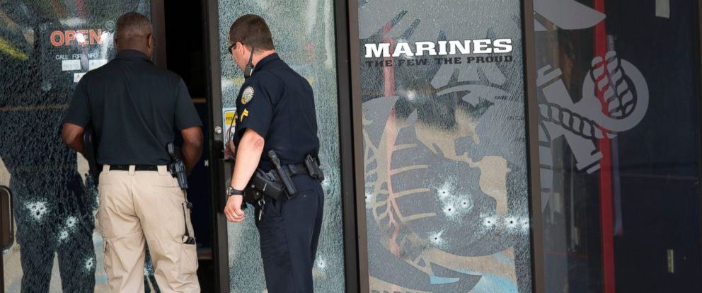 PHOTO: Police officers enter the Armed Forces Career Center through a bullet-riddled door after a gunman opened fire on the building, July 16, 2015, in Chattanooga, Tenn.