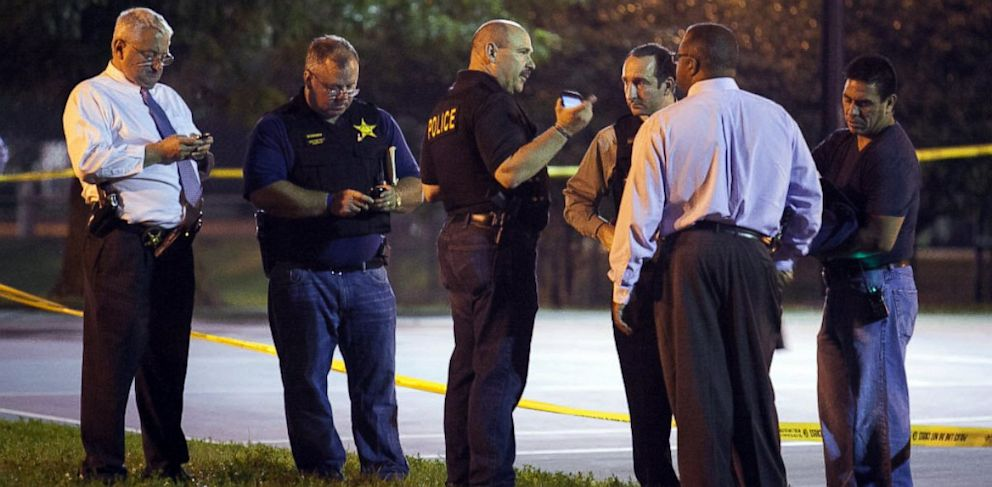 PHOTO: In this Sept. 19, 2013, photo, officials convene near the scene of a shooting at Cornell Square Park in Chicagos Back of the Yard neighborhood that left multiple victims including a 3-year-old boy.