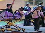 PHOTO: In this still frame made from Sept. 19, 2013, video provided by Ken Herzlich, officials and emergency responders tend to a victim at the scene where a number of people, including a 3-year-old child, were shot  in a city park in Chicago.