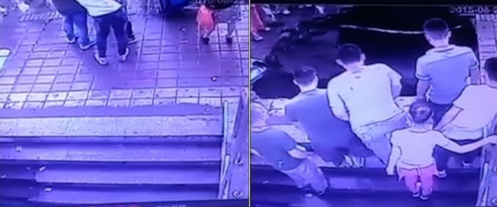 PHOTO: These screen grabs from video show a sinkhole that opened up at a bus stop in Harbin, China on August, 22, 2015.