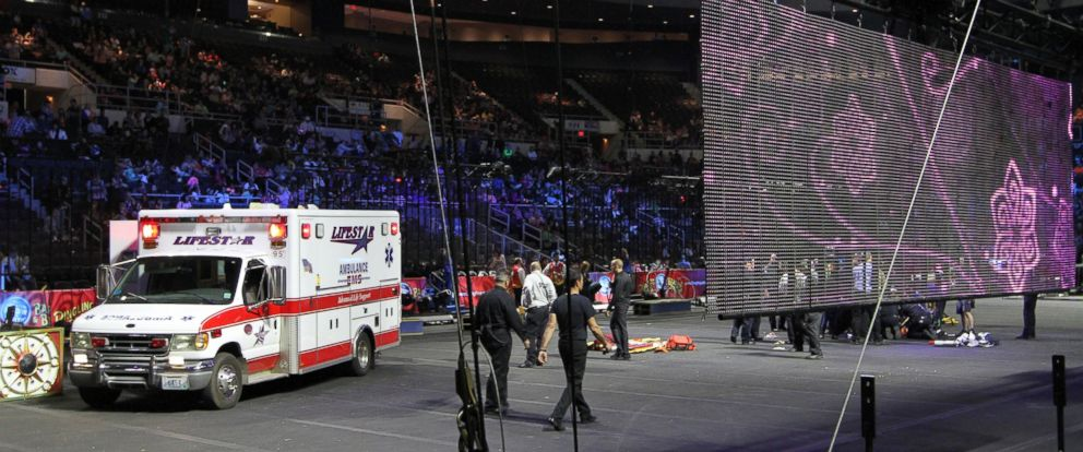 PHOTO: First responders work at the center ring after a platform collapsed during an aerial hair-hanging stunt at the Ringling Brothers and Barnum and Bailey Circus, Sunday, May 4, 2014, in Providence, R.I.