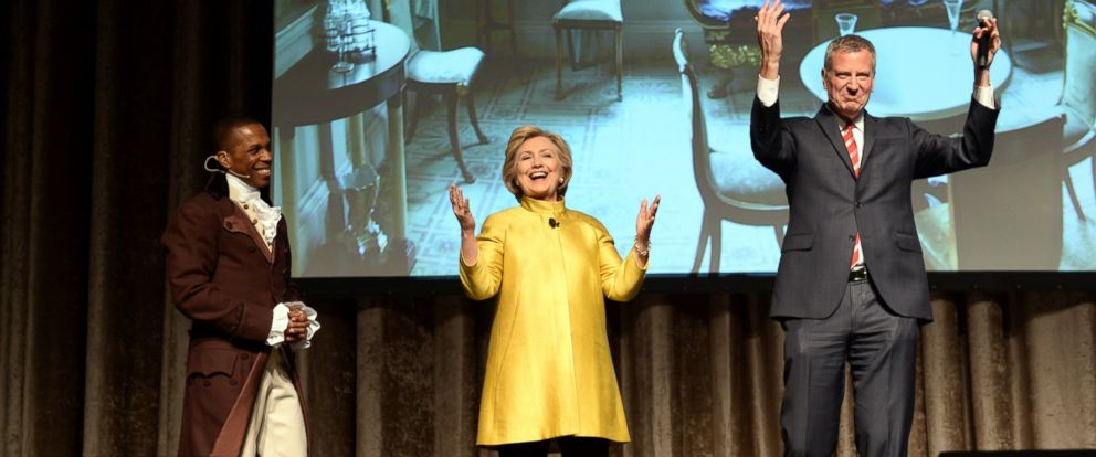 """PHOTO: Leslie Odum Jr., left, from the Broadway musical """"Hamilton,"""" presidential candidate Hillary Clinton, center, and New York City Mayor Bill de Blasio, right, perform at the Inner Circle Dinner at the New York Hilton Hotel on Saturday, April 9, 2016."""
