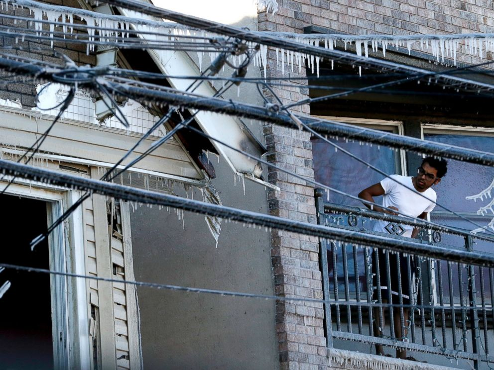 PHOTO: A man looks in the direction of an adjacent home which caught fire overnight on Jan. 8, 2015, in Jersey City, N.J.