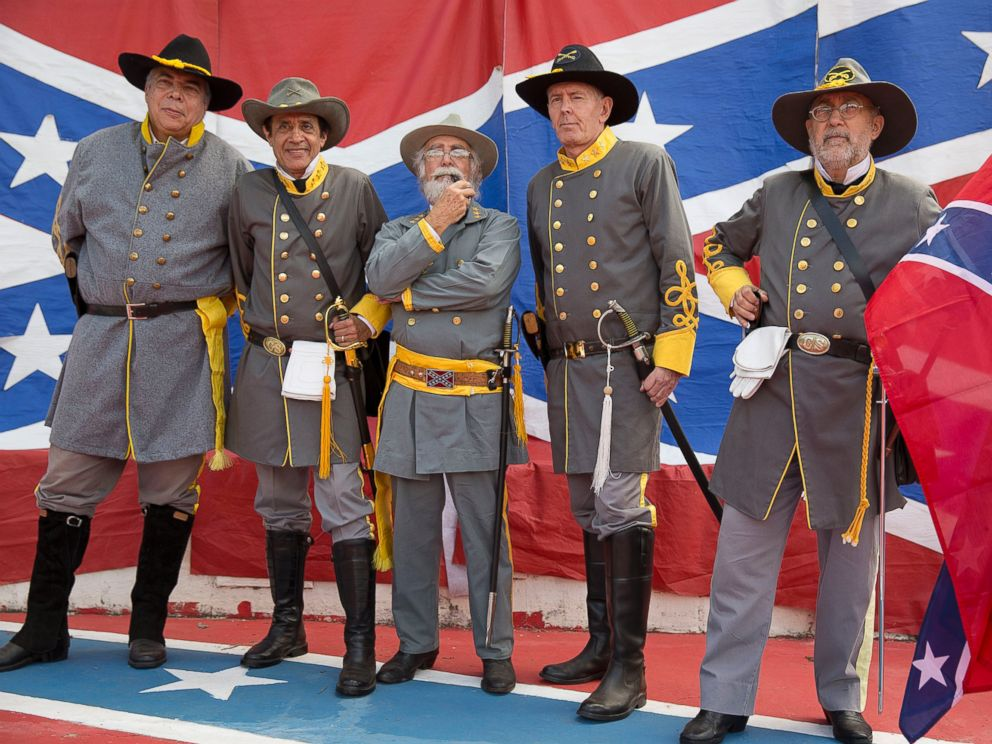 PHOTO: Descendants of American Southerners wearing Confederate-era uniforms pose for pictures during a party to celebrate the 150th anniversary of the end of the American Civil War in Santa Barbara dOeste, Brazil, April 26, 2015.