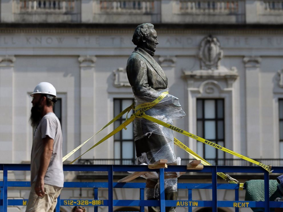 PHOTO: A statue of Confederate President Jefferson Davis is moved from its location in front of the schools main tower the University of Texas campus, Aug. 30, 2015, in Austin, Texas.