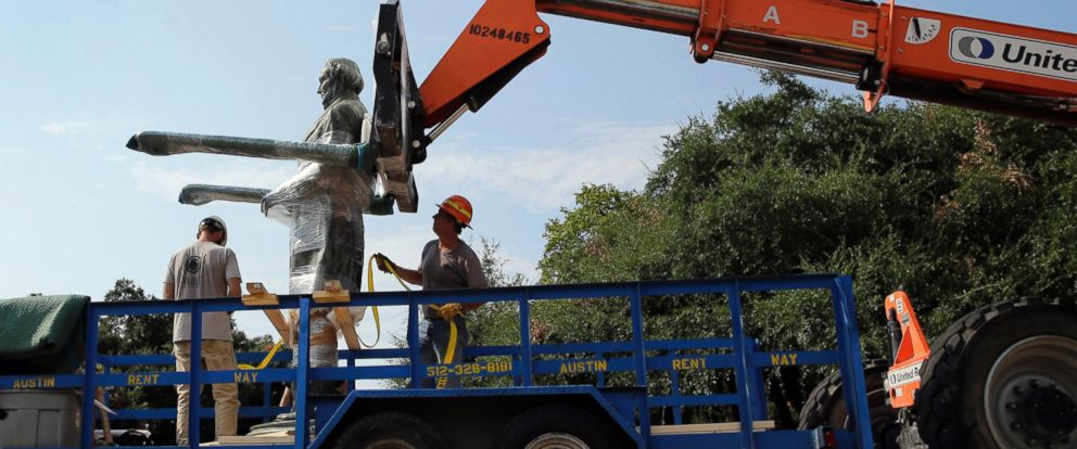 PHOTO: A statue of Confederate President Jefferson Davis is moved from its location in front of the schools main tower on the University of Texas campus, Aug. 30, 2015, in Austin, Texas.