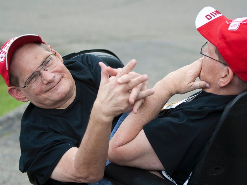 PHOTO: Donnie, left, and Ronnie Galyon, 62, travel inside their wheelchair near their Beavercreek, Ohio, home June 28, 2014.