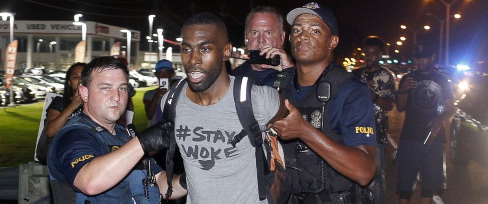 PHOTO: Police arrest activist DeRay McKesson during a protest along Airline Highway, a major road that passes in front of the Baton Rouge Police Department headquarters Saturday, July 9, 2016, in Baton Rouge, La.