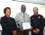 PHOTO: In this 2008 image provided by the Jackson, Miss. Police, Detective Eric Smith, center, flanked by Chief Rebecca Coleman, left, and Assistant Chief Lee Vance accepts the Certificate of Commendation on behalf of Detective Amos Clinton in Jackson, Mi