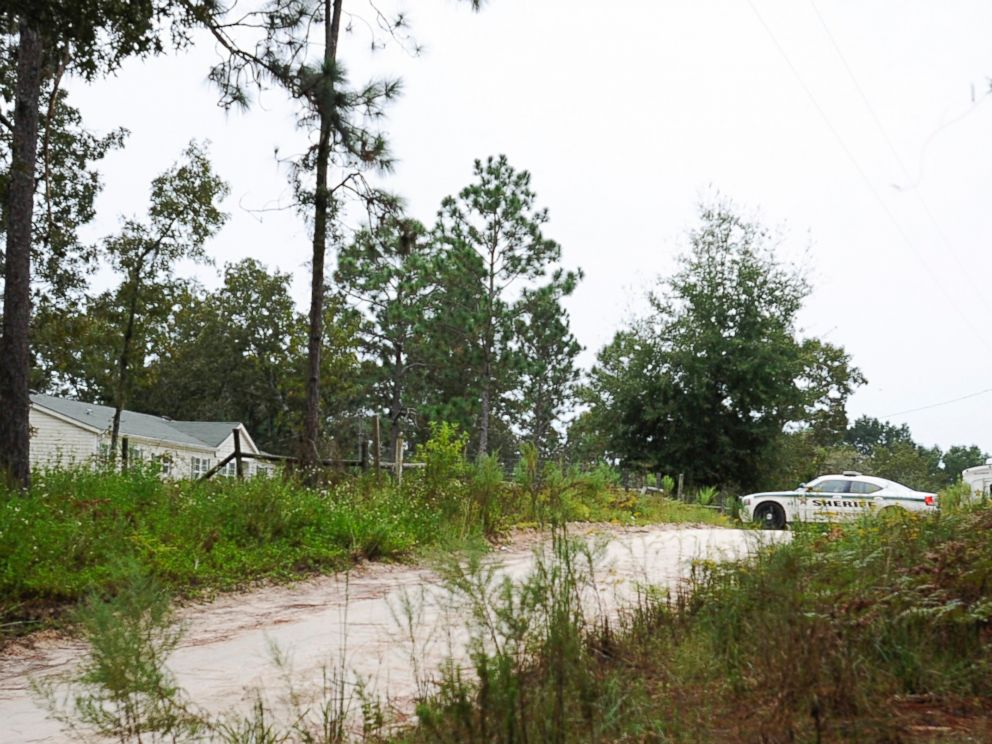 PHOTO: A Gilchrist County sheriffs vehicle sits on the property, Sept. 19, 2014, where 51-year-old Don Spirit allegedly shot and killed his adult daughter and six of his grandchildren, as well as himself in Bell, Fla.