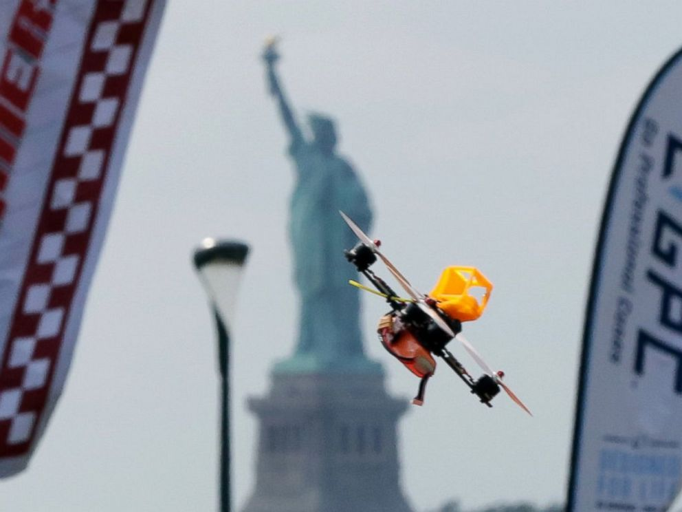 PHOTO: A pilot flies a small racing drone through an obstacle course on Governors Island, a former military installation in New York Harbor, Aug. 5, 2016. Drone pilots are gathering in New York City to compete in the National Drone Racing Championship.