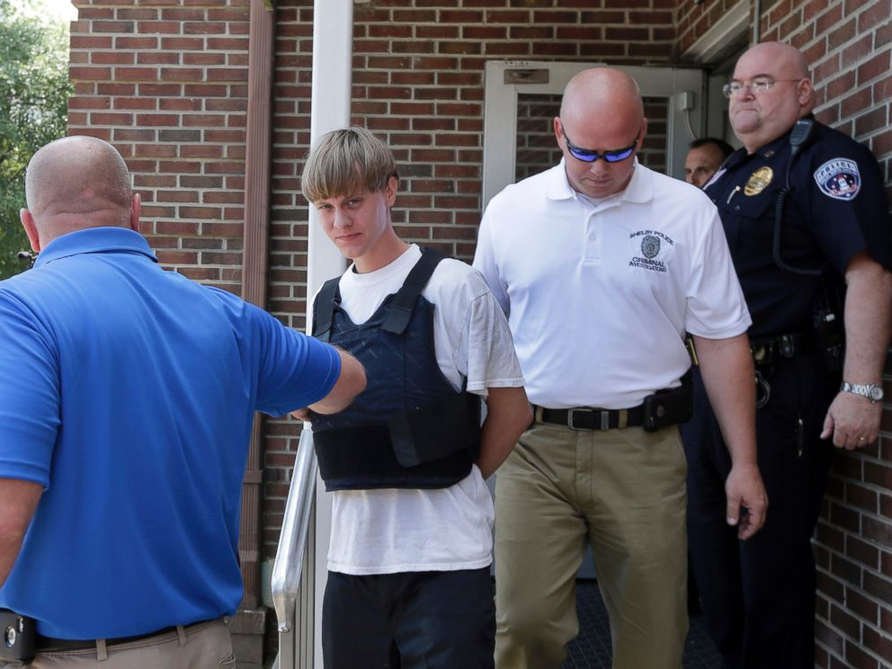 PHOTO: Charleston, S.C., shooting suspect Dylann Storm Roof, center, is escorted from the Sheby Police Department in Shelby, N.C., June 18, 2015.