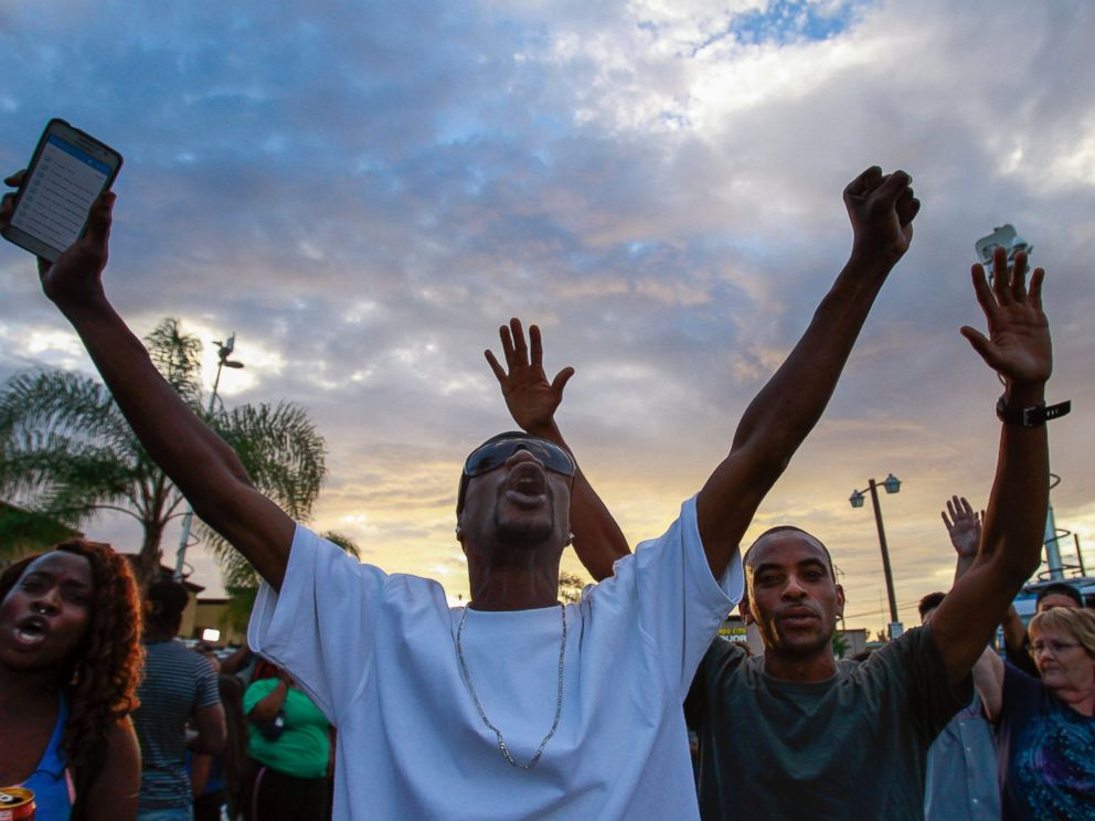 PHOTO: People protest at the scene where a black man was shot by police earlier in El Cajon, east of San Diego, Calif., Sept. 27, 2016.