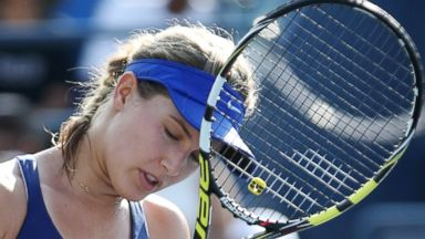 PHOTO: Eugenie Bouchard reacts after a shot against Ekaterina Makarova during the fourth round of the 2014 U.S. Open tennis tournament, Sept. 1, 2014, in New York.