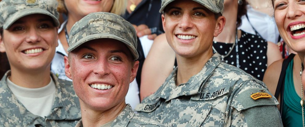 PHOTO: U.S. Army First Lt. Shaye Haver, center, and Capt. Kristen Griest, right, pose for photos with other female West Point alumni after an Army Ranger school graduation ceremony, Aug. 21, 2015, at Fort Benning, Ga.