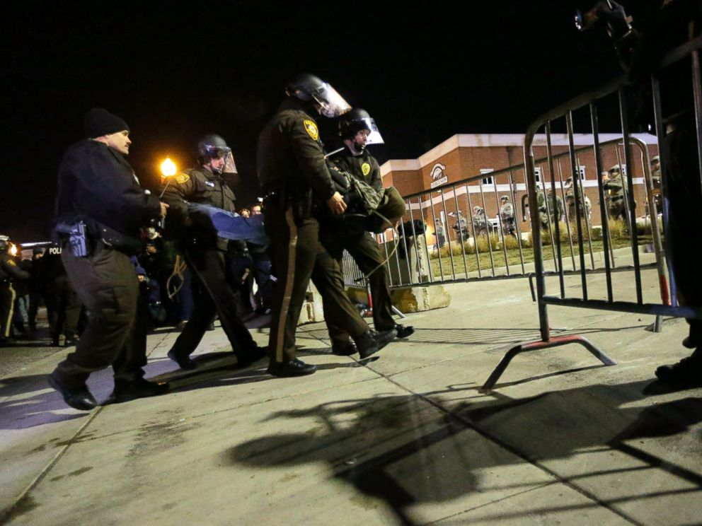 police fire tear gas at protesters amid renewed ferguson unrest