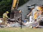 PHOTO: Crews begin to demolish a home damaged by a sinkhole that opened up in Dunedin, Fla., Nov. 15, 2013.
