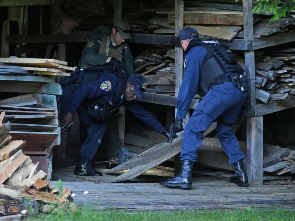PHOTO: New York State Department of Corrections Officers and a forest ranger search a barn in Owls Head, N.Y. for convicted murderers Richard Matt and David Sweat, June 26, 2015.