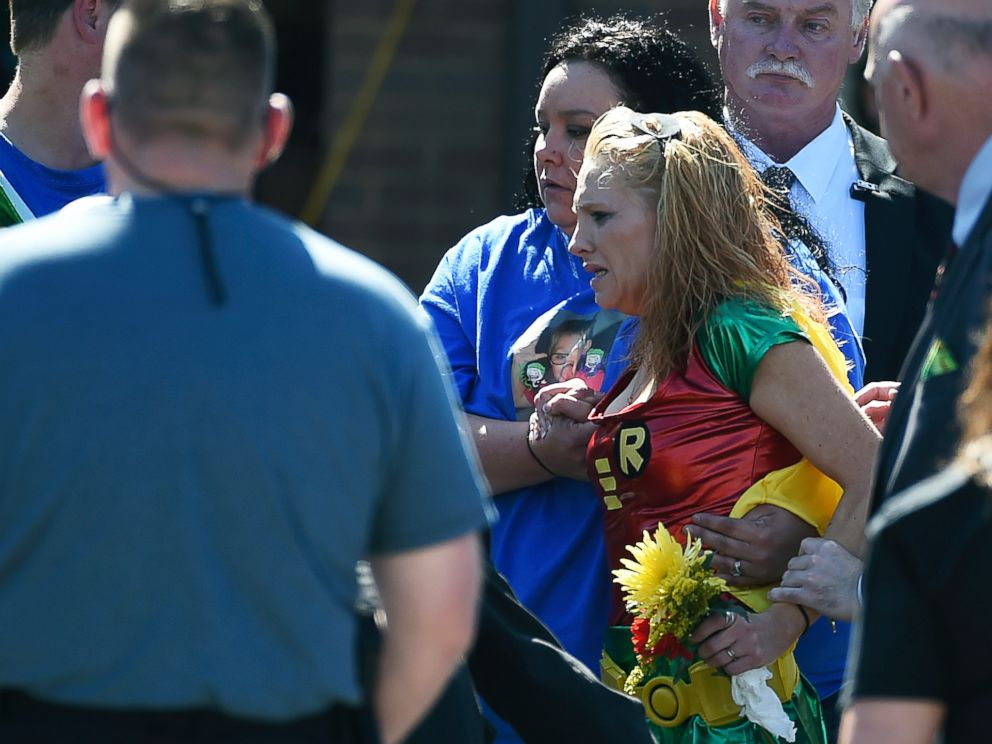 PHOTO: Renae Hall, right, mother of Jacob Hall, reacts as her son is placed into a hearse during a superhero-themed funeral service for Jacob Hall at Oakdale Baptist Church, Oct. 5, 2016, in Townville, South Carolina.