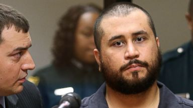 PHOTO: George Zimmerman, acquitted in the high-profile killing of unarmed black teenager Trayvon Martin, listens to defense counsel Daniel Megaro, left, Nov. 19, 2013, in Sanford, Fla.