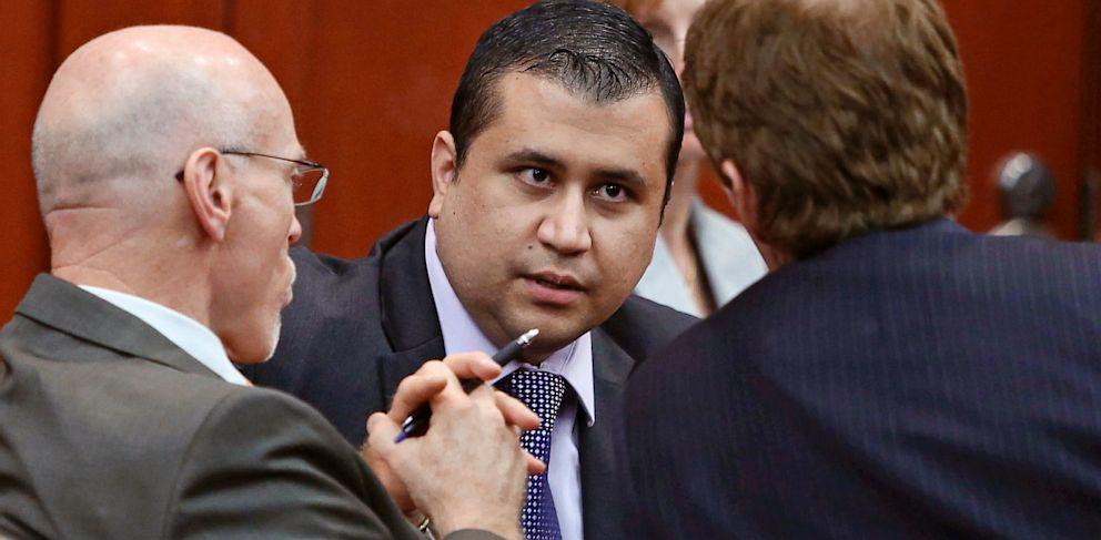 PHOTO: George Zimmerman speaks to his attorneys