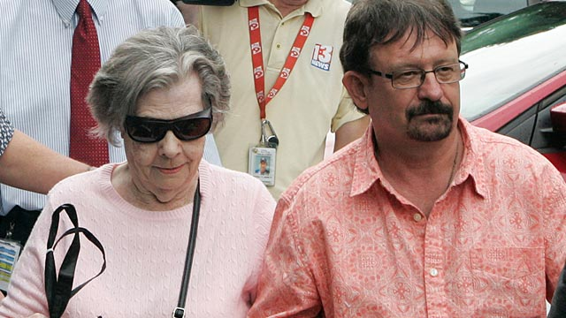 PHOTO: Powerball winner Gloria C. Mackenzie, 84, left, leaves the lottery office escorted by her son, Scott Mackenzie, after claiming a single lump-sum payment of about $370.9 million before taxes, June 5, 2013, in Tallahassee, Fla.
