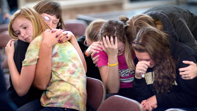 PHOTO: A parent and students console each other over the loss of their friends during a prayer meeting held at Pleasant Garden First Baptist Church, following a series of shootings by Mary Ann Holder, Pleasant Garden, N.C., Nov. 21, 2011.