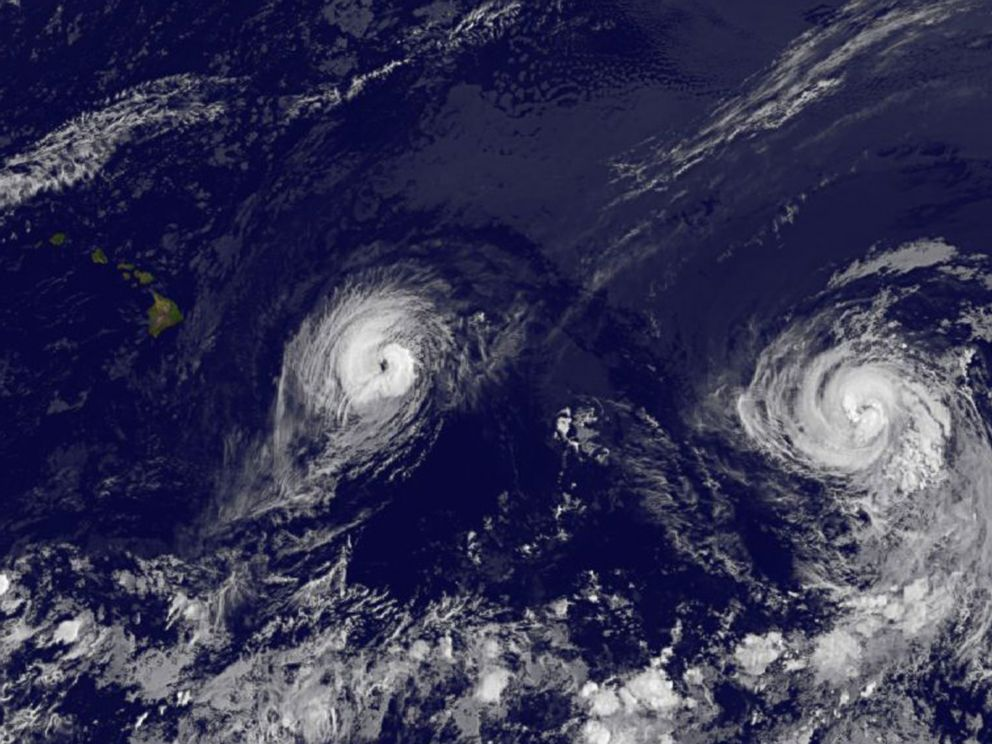 PHOTO: This image provided by NOAA taken Aug. 7, 2014 at 2 a.m. EDT shows Hurricane Iselle, left and Hurricane Julio approaching Hawaii.