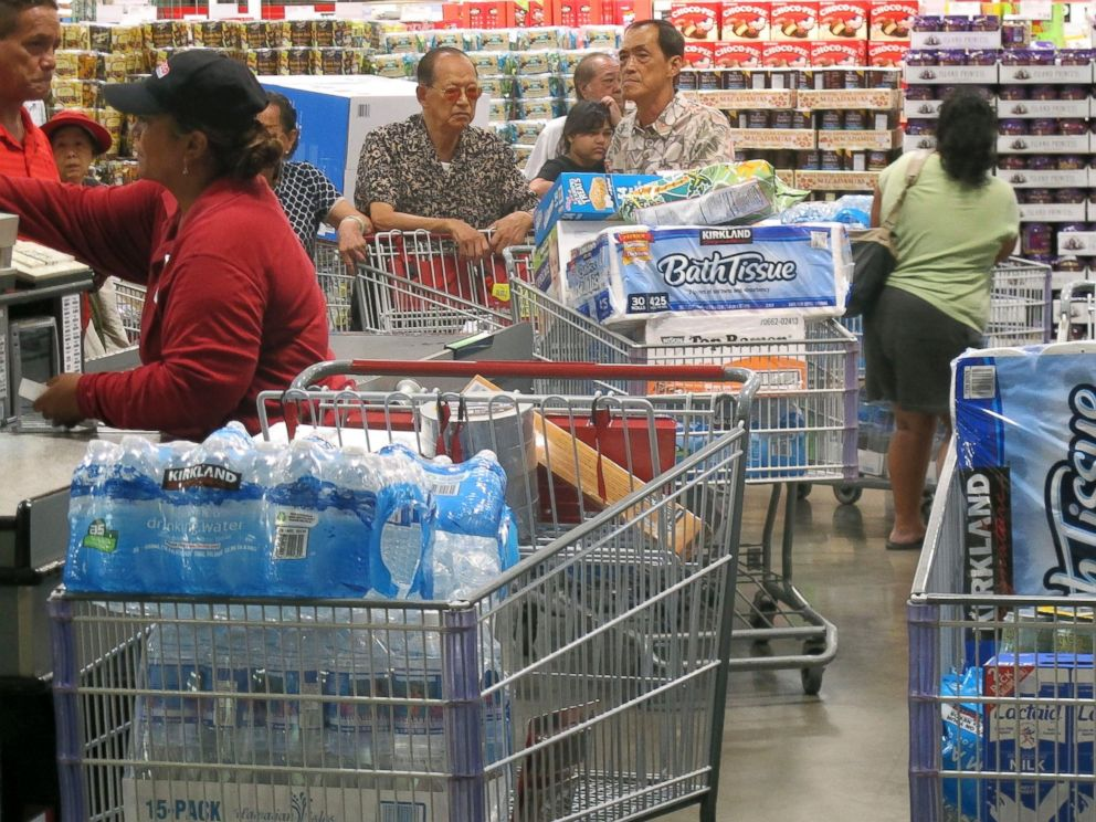 PHOTO: Shoppers stock up on cases of bottled water and other supplies in preparation for a hurricane and tropical storm heading toward Hawaii at the Iwilei Costco in Honolulu on Tuesday, Aug. 5, 2014.