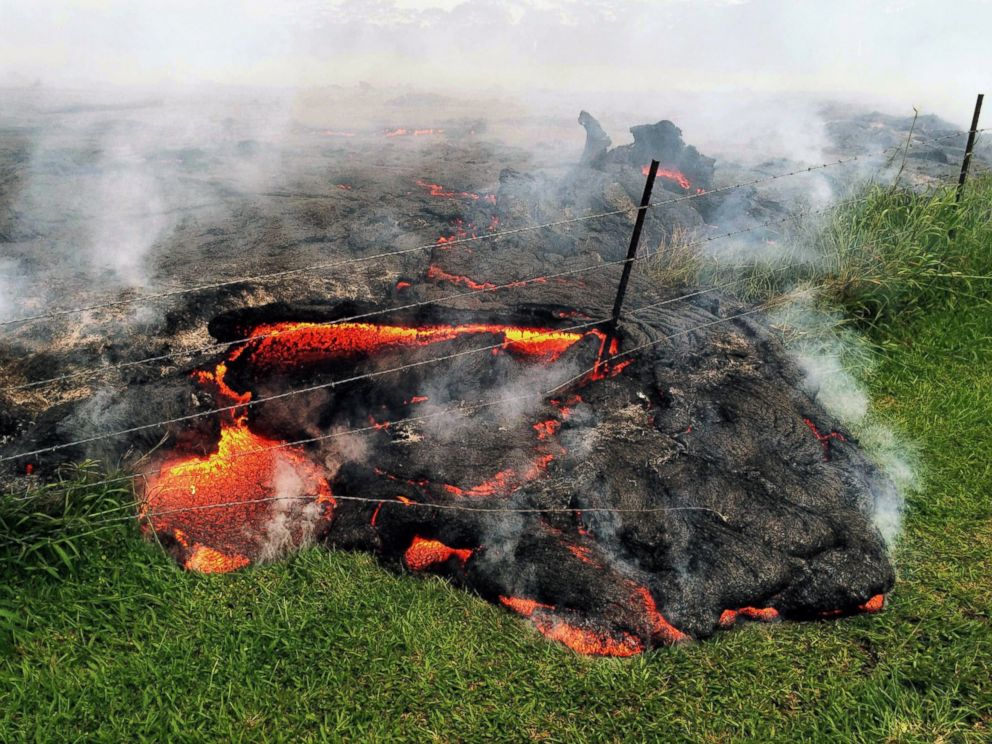 PHOTO: Lava flow advances across the pasture between the Pahoa cemetery and Apaa Street, engulfing a barbed wire fence, near the town of Pahoa on the Big Island of Hawaii, Oct. 25, 2014.