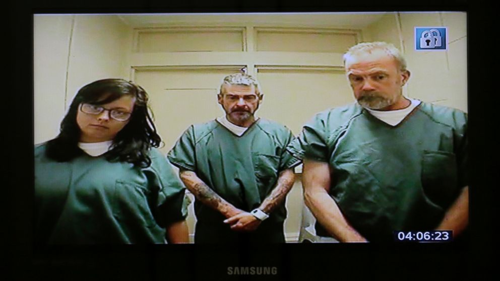Kimberly Arendt, John Cramsey and Dean Smith are seen on a monitor during their video arraignment at Hudson County Courthouse, Wednesday, June 22, 2016, in Jersey City, N.J.