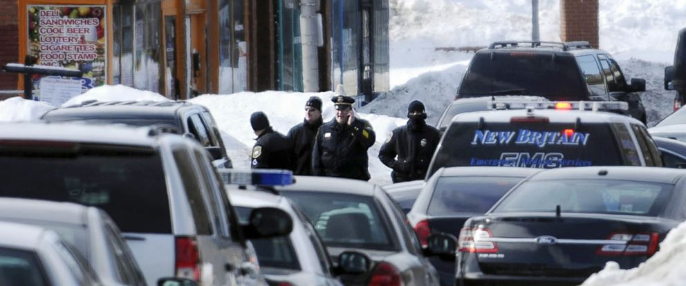 PHOTO: In this Monday, Feb. 23, 2015 photo, police surround the Achieve Financial Credit Union in New Britain, Conn.