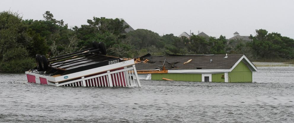PHOTO: Two trailers sit overturned in the creek behind the Hatteras Sands Campground in Hatteras, N.C., Sept. 3, 2016 after Tropical Storm Hermine passed the Outer Banks.