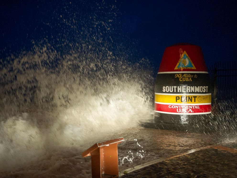 PHOTO: Waves crash against the Southernmost Point in Key West, Fla., Saturday, Sept. 9, 2017. Hurricane Irmas leading edge bent palm trees and spit rain as the storm swirled toward Florida on Saturday.