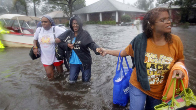 PHOTO:St. John the Baptist Parish sheriff?s deputies evacuate residents from the River Forest subdivision in LaPlace, La. as wind-driven tides flood the neighborhood Wednesday, Aug. 29, 2012.