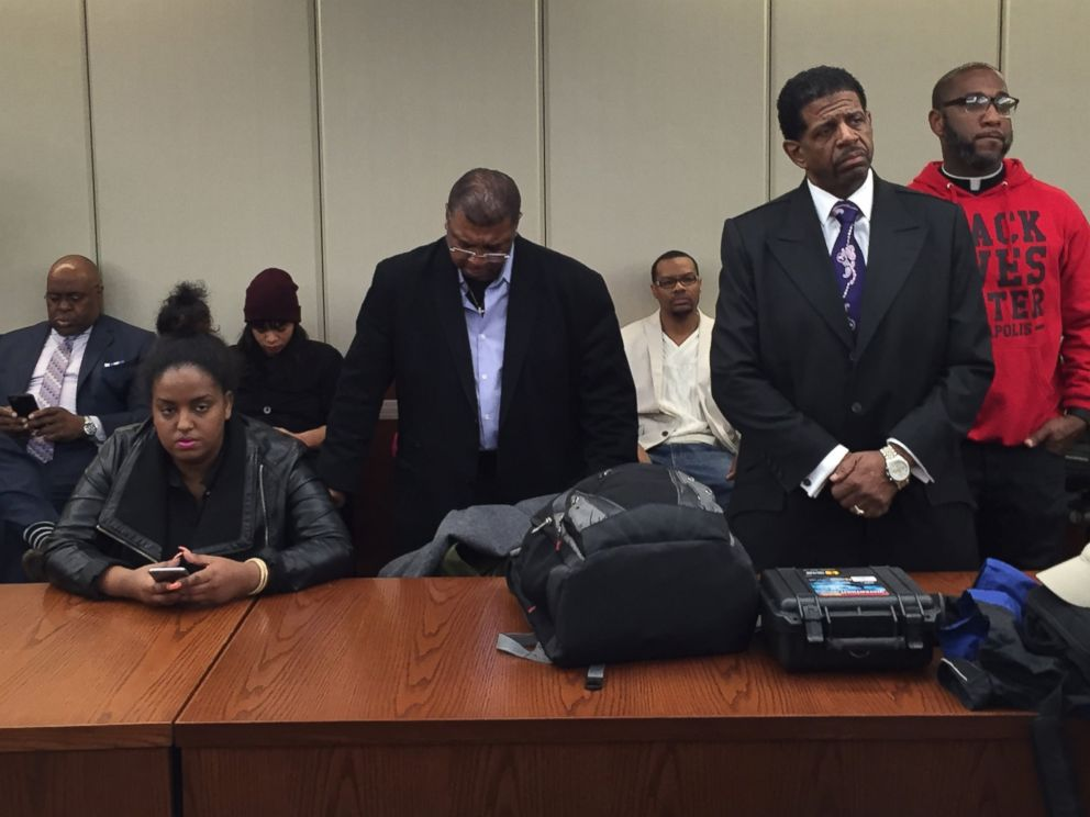 PHOTO: People listen as the Hennepin County Attorney announces that two Minneapolis police officers will not be charged in the November fatal shooting of Jamar Clark during a press conference, March 30, 2016 in Minneapolis.