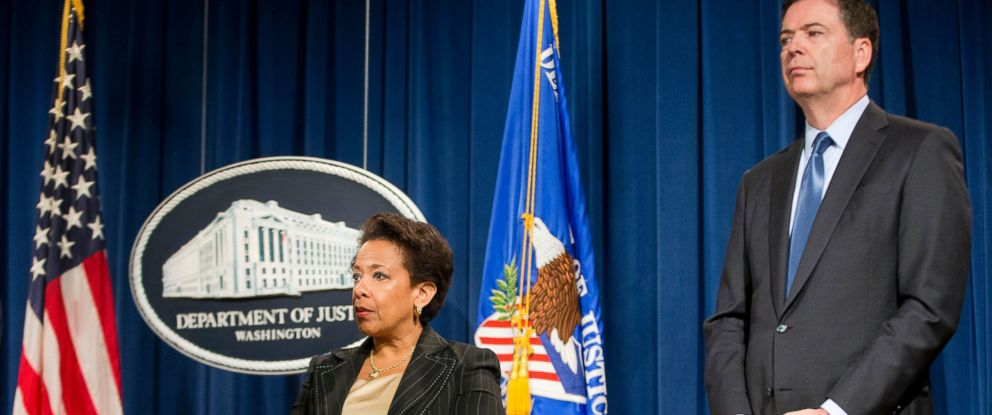 PHOTO: Attorney General Loretta Lynch and FBI Director James Comey listen to questions from members of the media regarding the investigation into the recent church shooting in Charleston, SC. at the Justice Department in Washington, June 18, 2015.