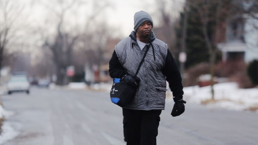 In this Jan. 29, 2015, photo, James Robertson toward Woodward Aveune in Detroit to catch his morning bus to Somerset Collection in Troy before walking to his job at Schain Mold & Engineering in Rochester Hills.